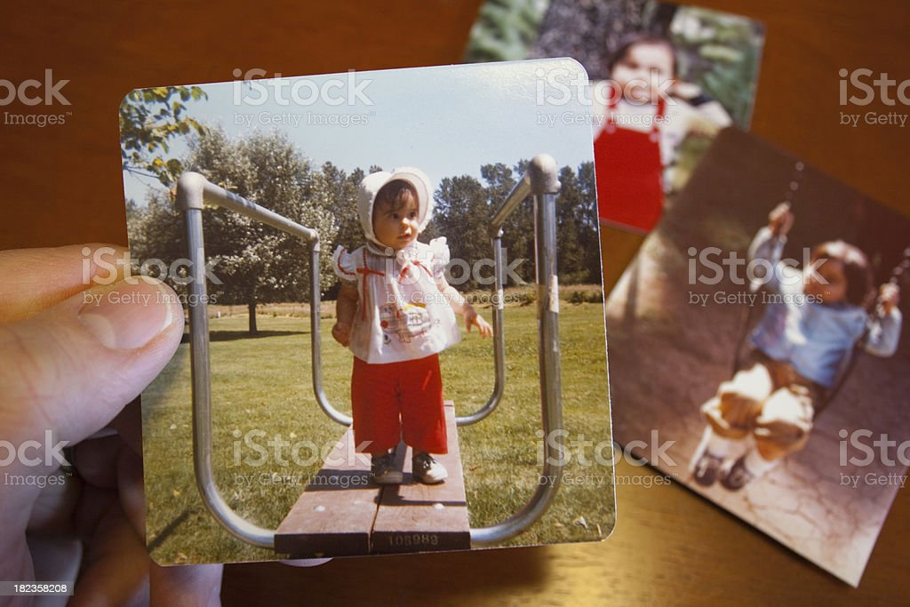 Vintage photo of young girl on park playset royalty-free stock photo