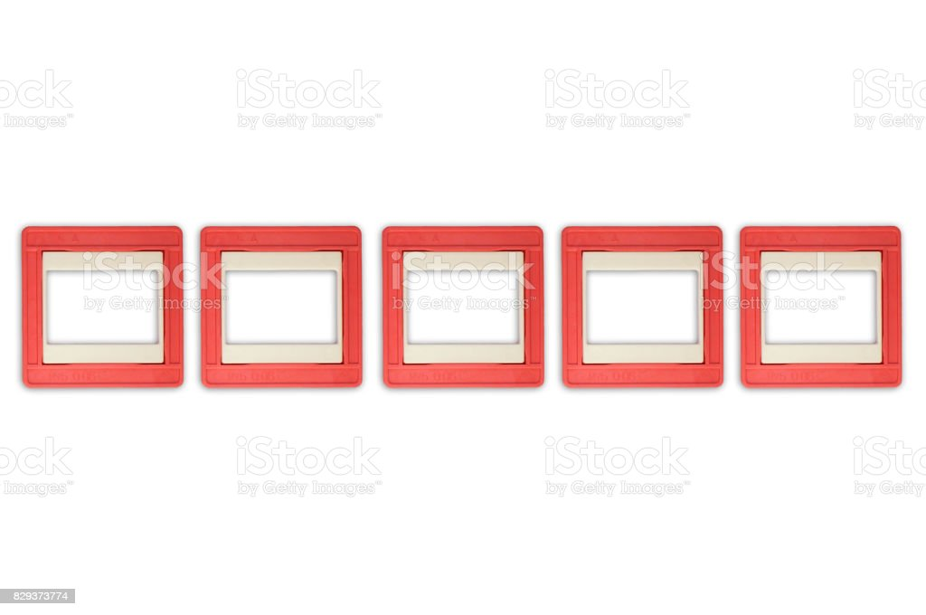 Vintage photo slides in a rows isolated on white background stock photo