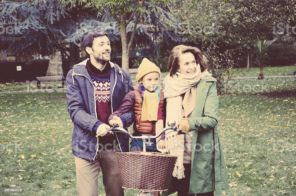 Vintage photograph of a happy family posing in a park stock photo