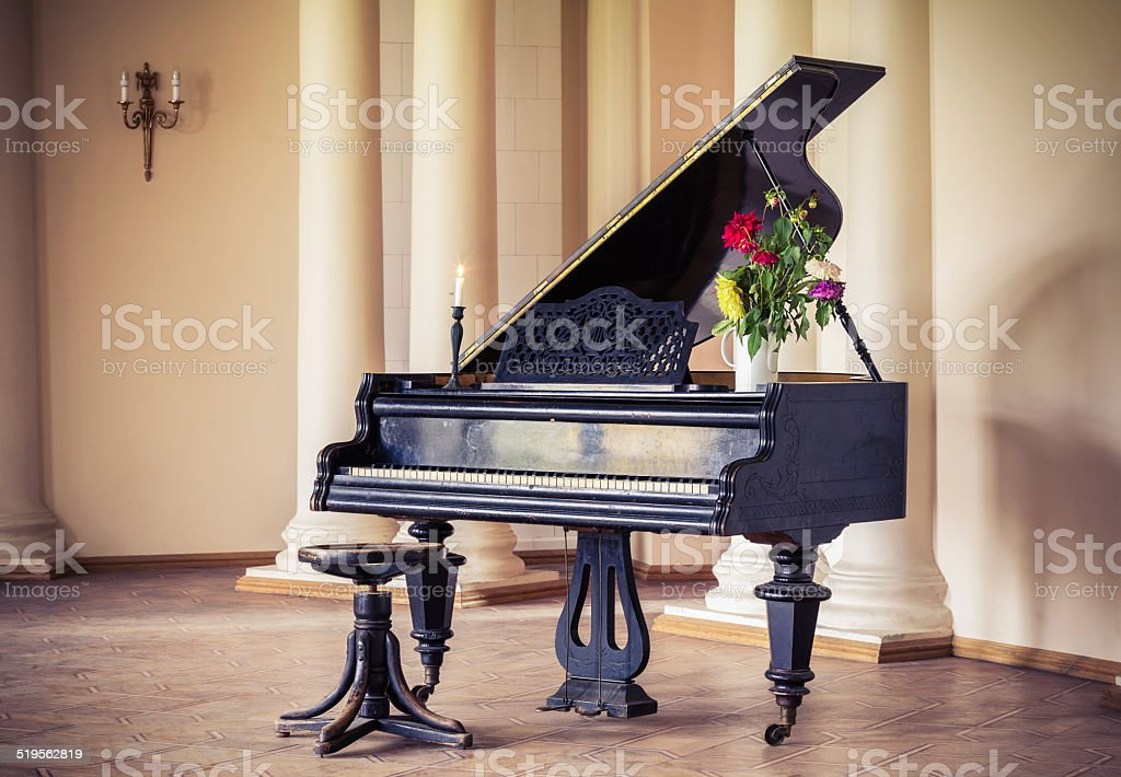 Vintage piano in the old manor stock photo