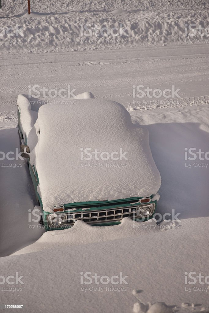 Vintage Pickup Truck Covered in Snow stock photo