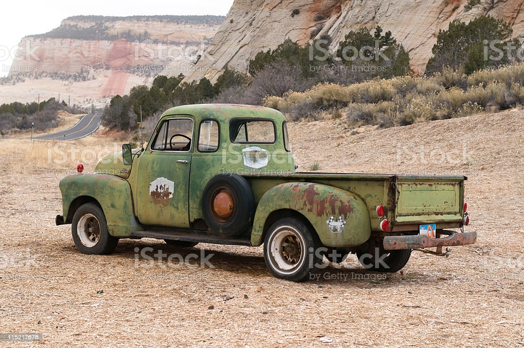 Vintage Pick-Up Truck Facing Road stock photo
