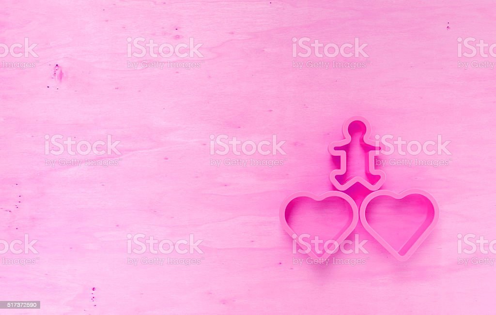 Vintage pink tone heart on wood background stock photo