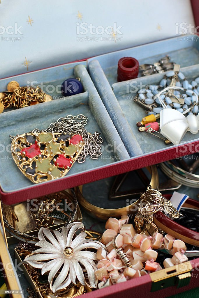 Vintage Pins, Bracelets, and Necklaces in Jewelry Box royalty-free stock photo