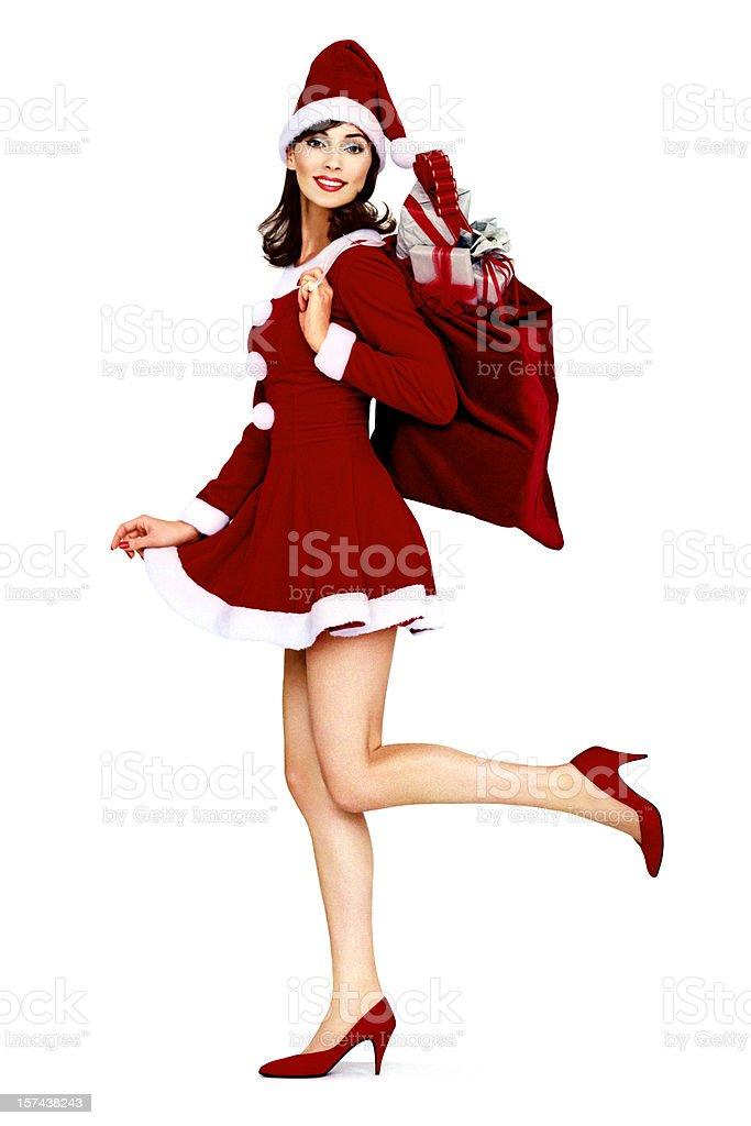 Vintage Pin-up As Santa Claus Look Holding A Christmas Bag stock photo