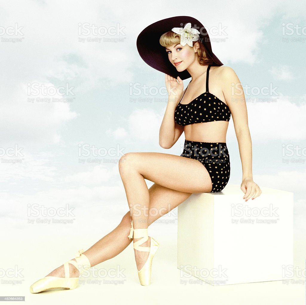 Vintage Pin-up Girl On A Sky Background stock photo