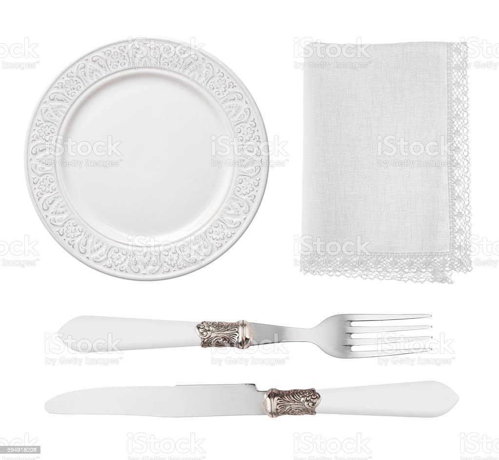 Vintage plate, knife, fork and napkin isolated on white background stock photo