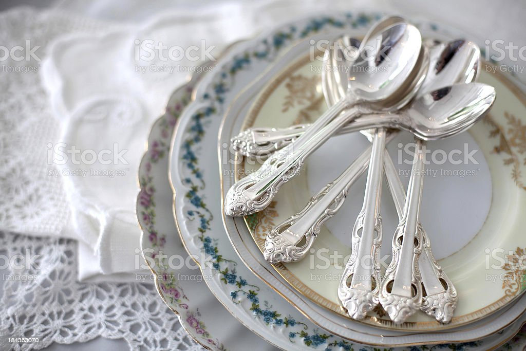 Vintage plates with silver teaspoons stock photo