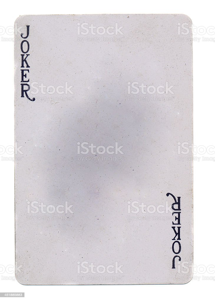 vintage playing card joker paper background stock photo