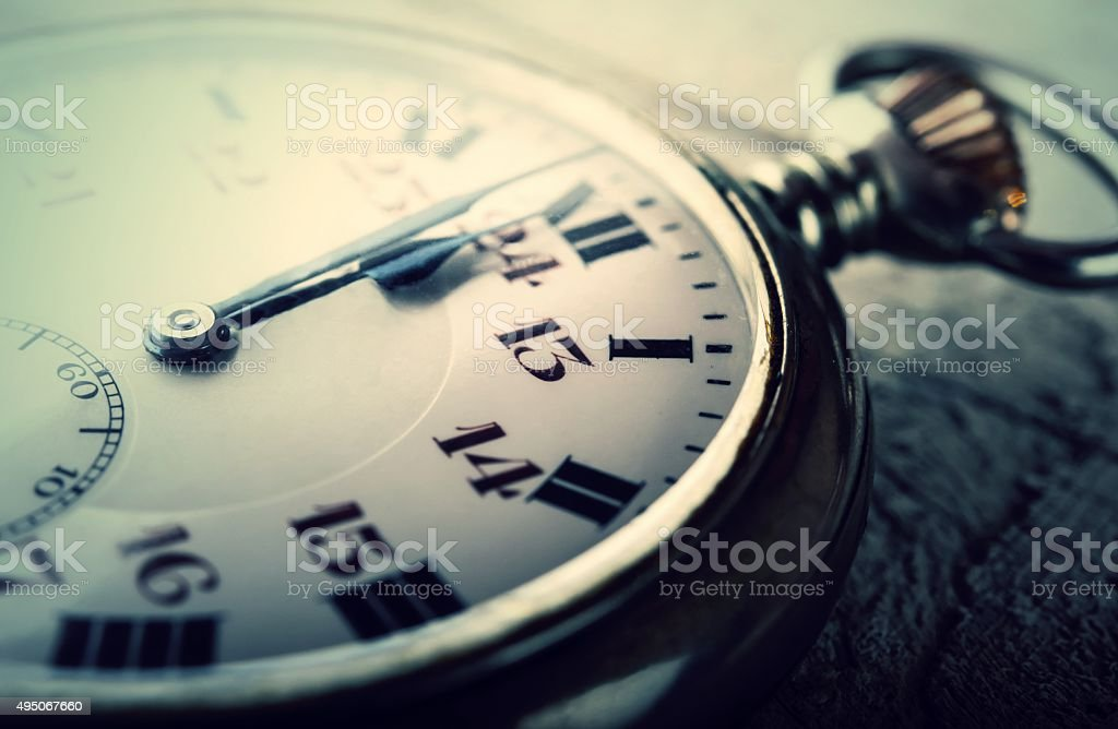vintage pocket watch clock striking midnight happy new year stock photo