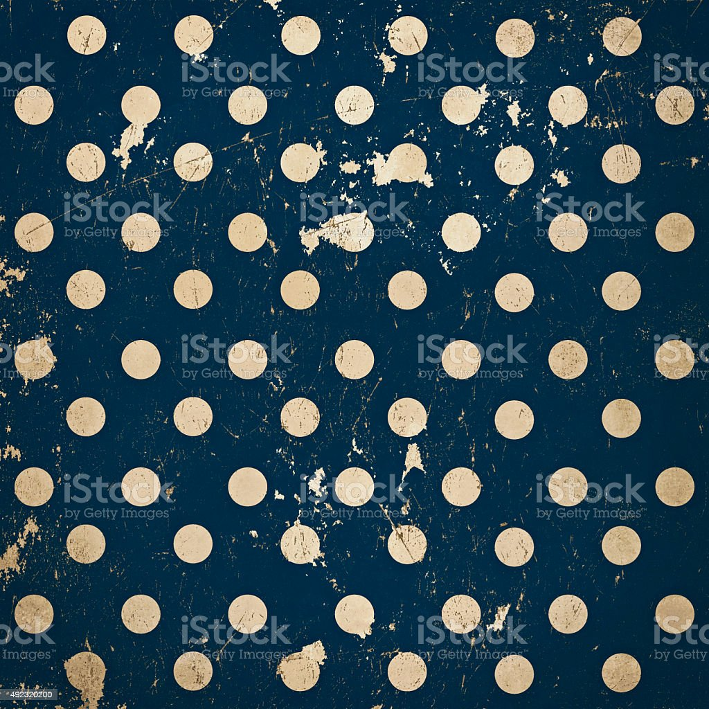 Vintage polka dots ultramarine blue background, grunge scratched metal texture stock photo