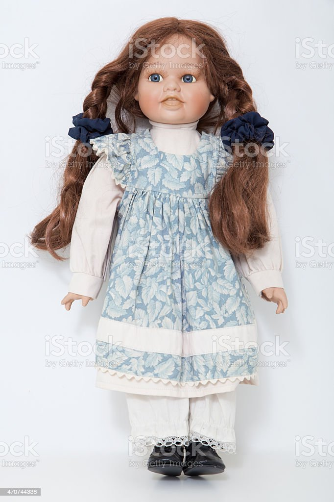 Vintage porcelain doll girl with long braids brown hair stock photo