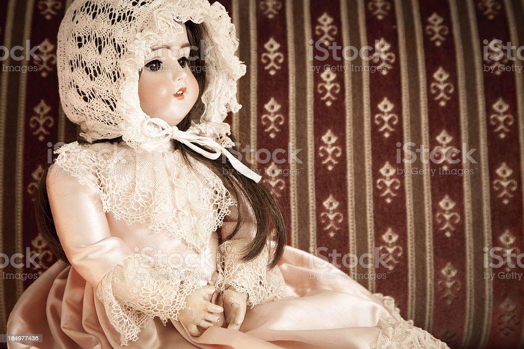 Vintage porcelain doll stock photo