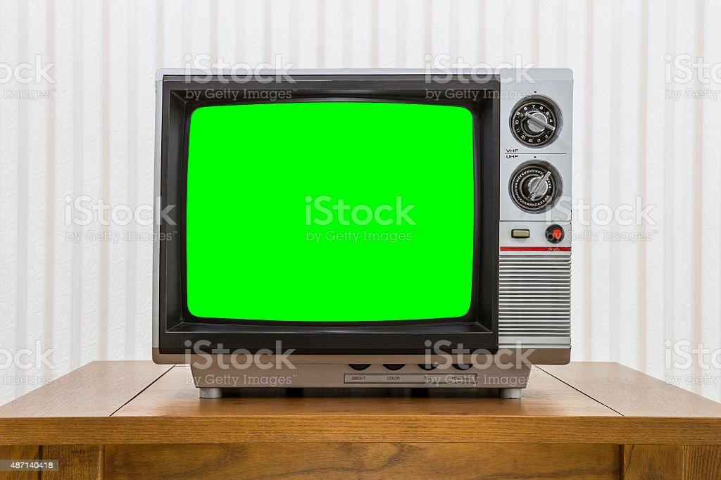 Vintage Portable Television on Table with Chroma Screen stock photo