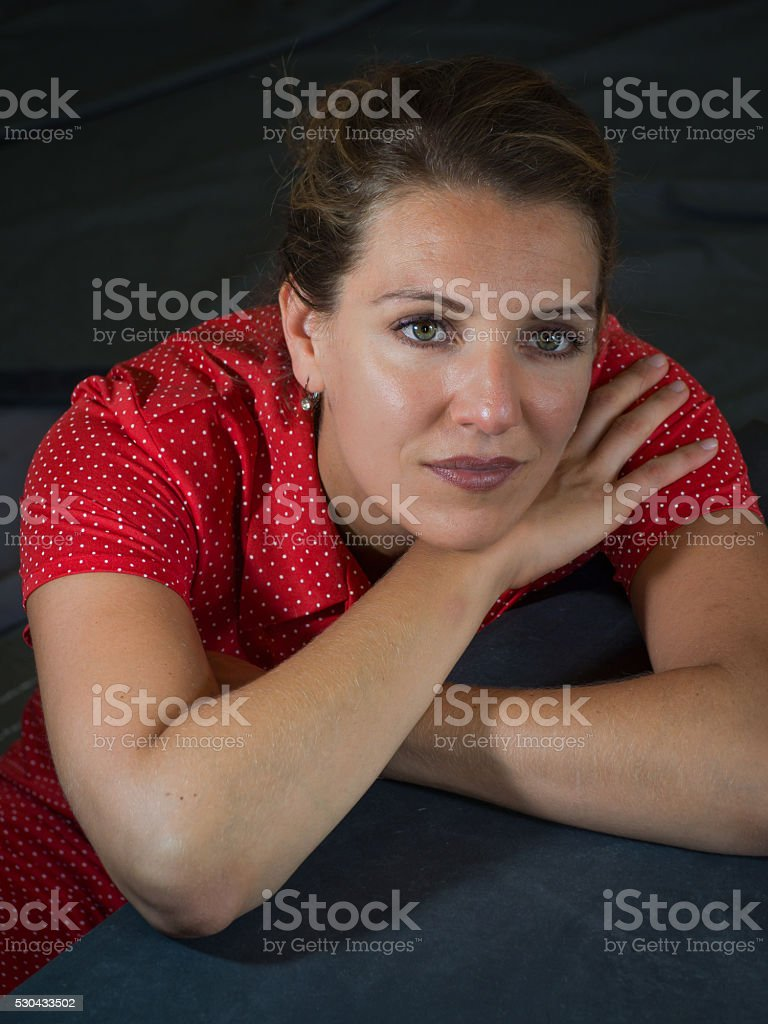 Vintage portrait of a beautiful young woman in a dress stock photo