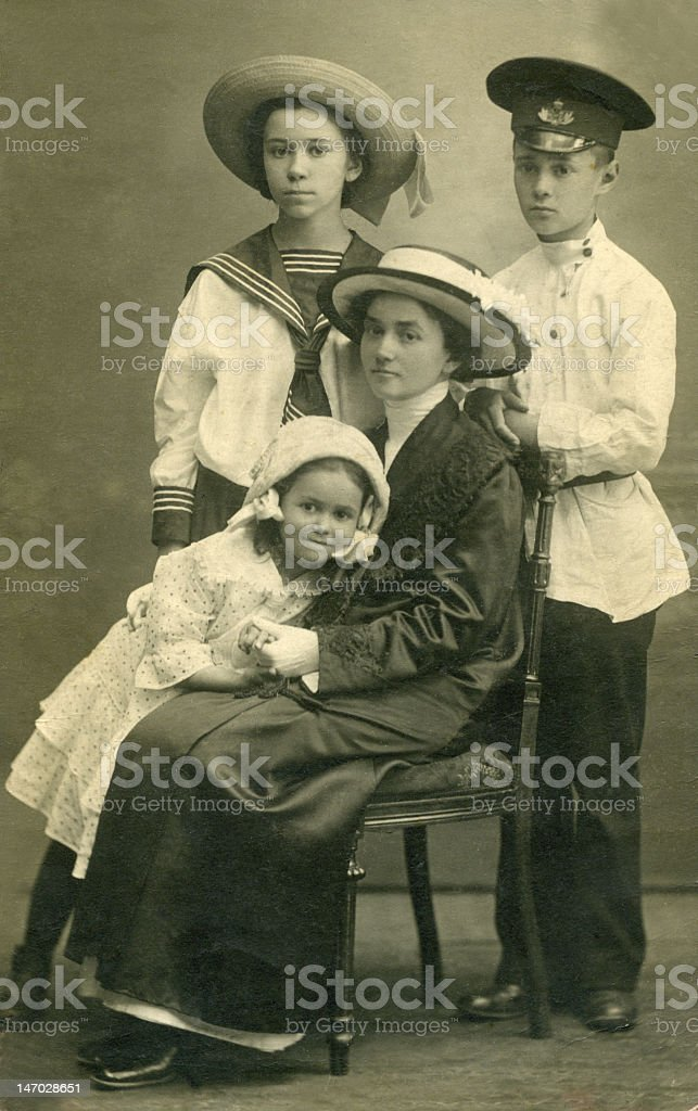 Vintage portrait of a family of four stock photo