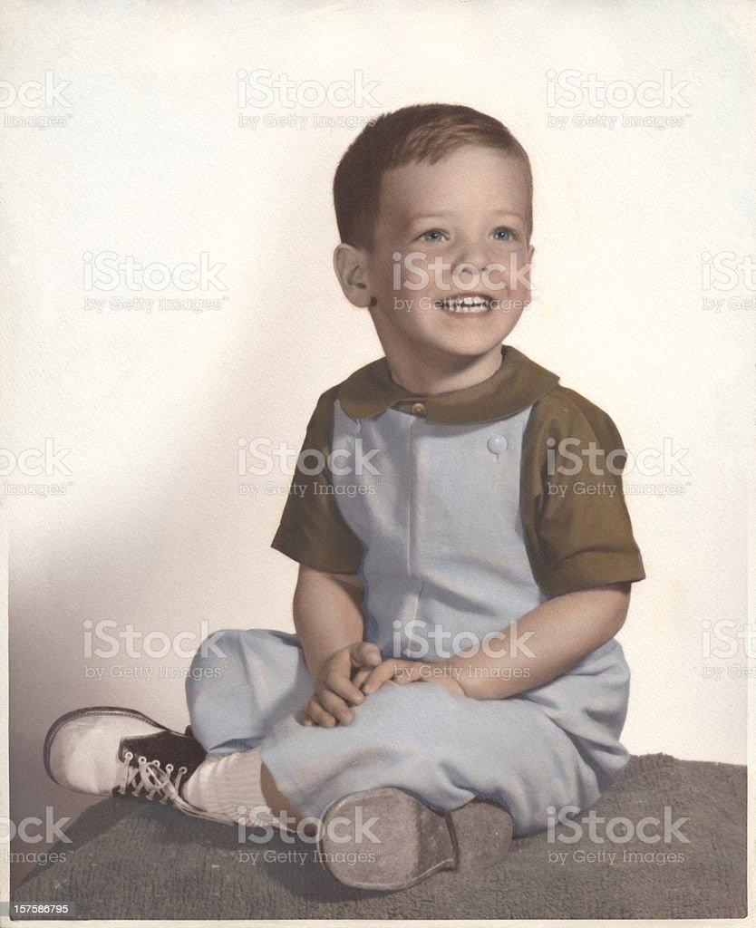 A vintage portrait of a young boy smiling stock photo