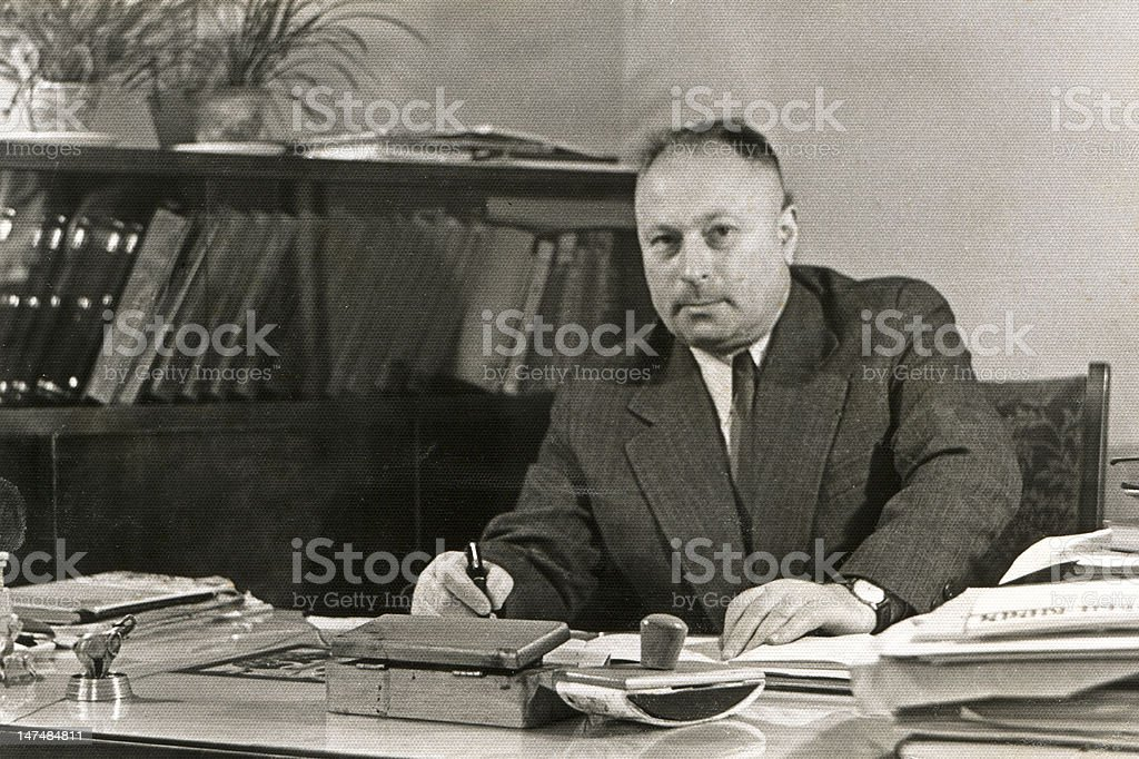 Vintage portrait of man in his office stock photo