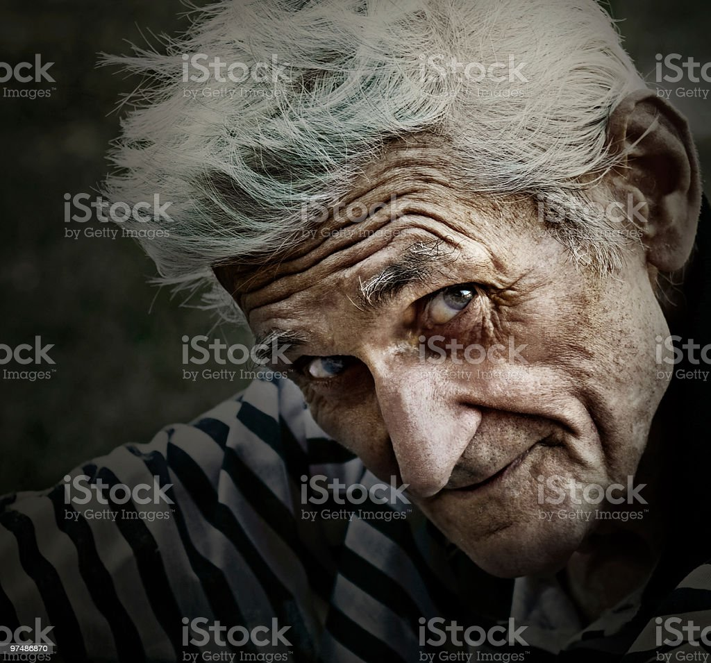 Vintage portrait of senior man with wisdom smile stock photo