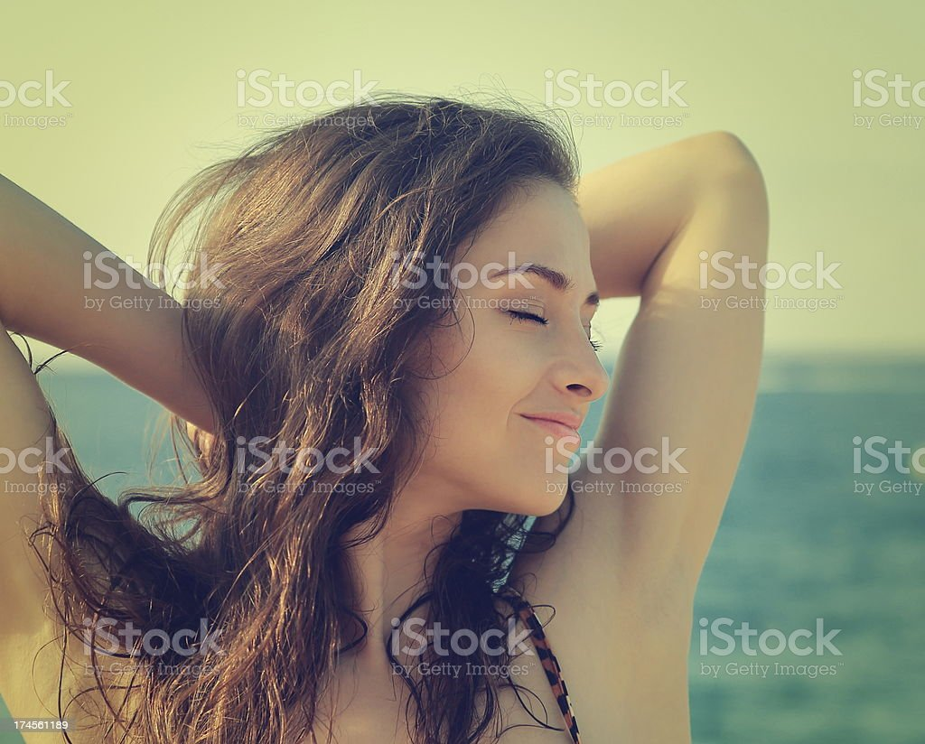 Vintage portrait of woman enjoying on summer sea. Closeup stock photo