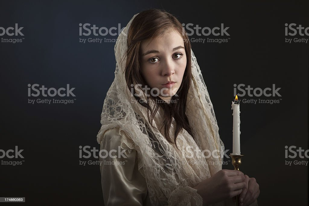 Vintage Portrait of Young Woman Holding Candle stock photo