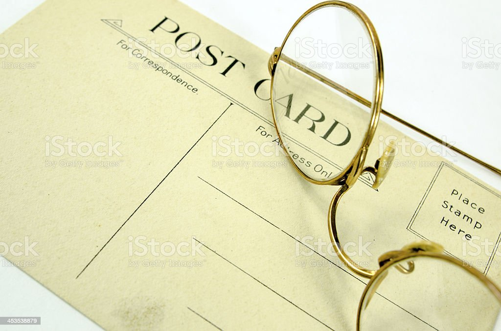 Vintage Postcard and Glasses royalty-free stock photo