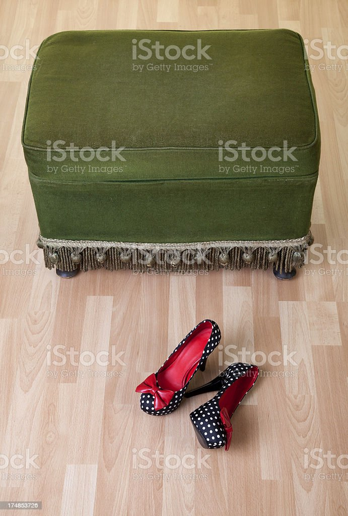 vintage pouffe with high heel shoes royalty-free stock photo