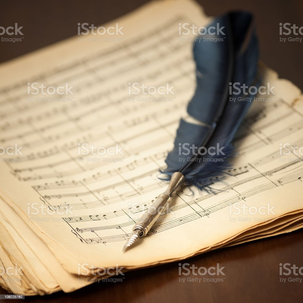 Vintage Quill on Classical Music Sheets stock photo