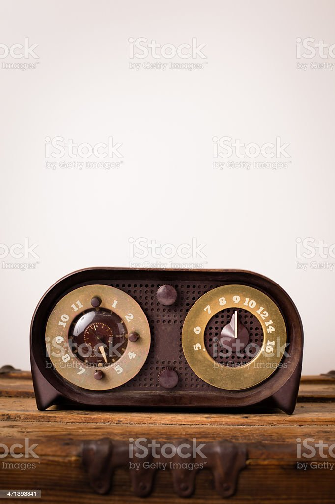 Vintage Radio Sitting on Wood Trunk, With Copy Space stock photo
