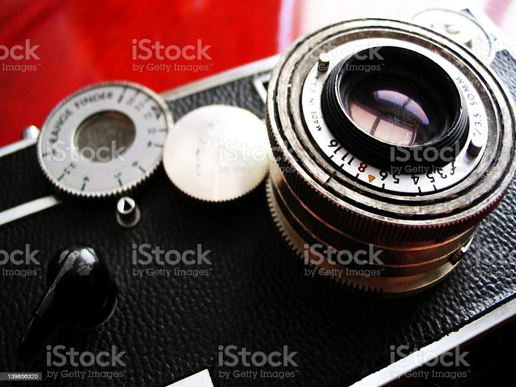 Vintage rangefinder camera on cherry desk stock photo