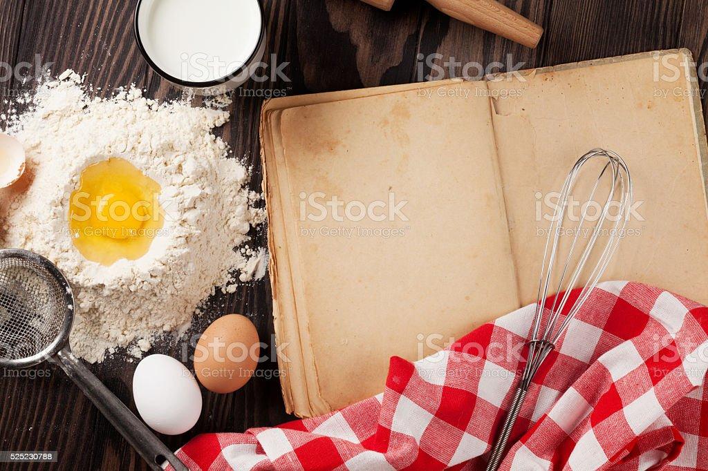 Vintage recipe book, utensils and ingredients stock photo
