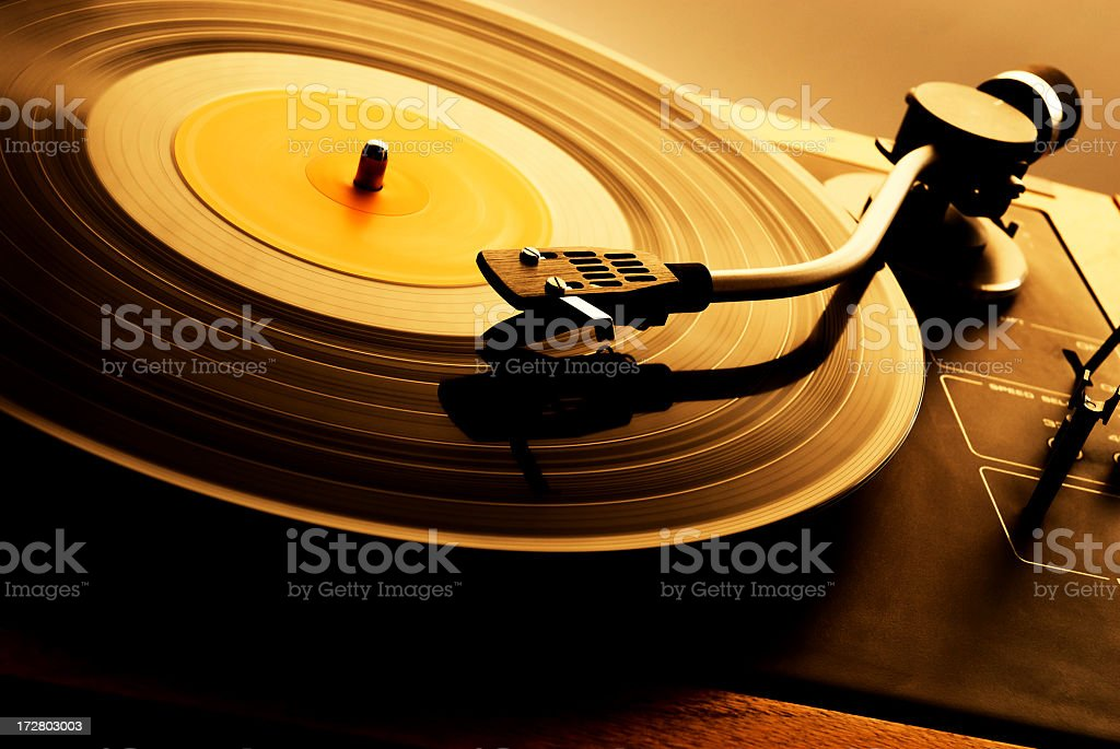 A vintage record spinning on a turntable stock photo
