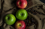 Vintage red and green apple with coffee bean