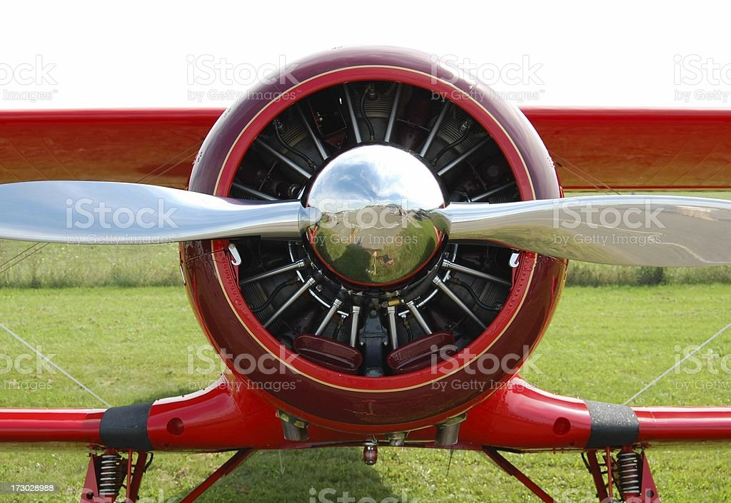 Vintage red biplane radial engine, spinner and propeller stock photo