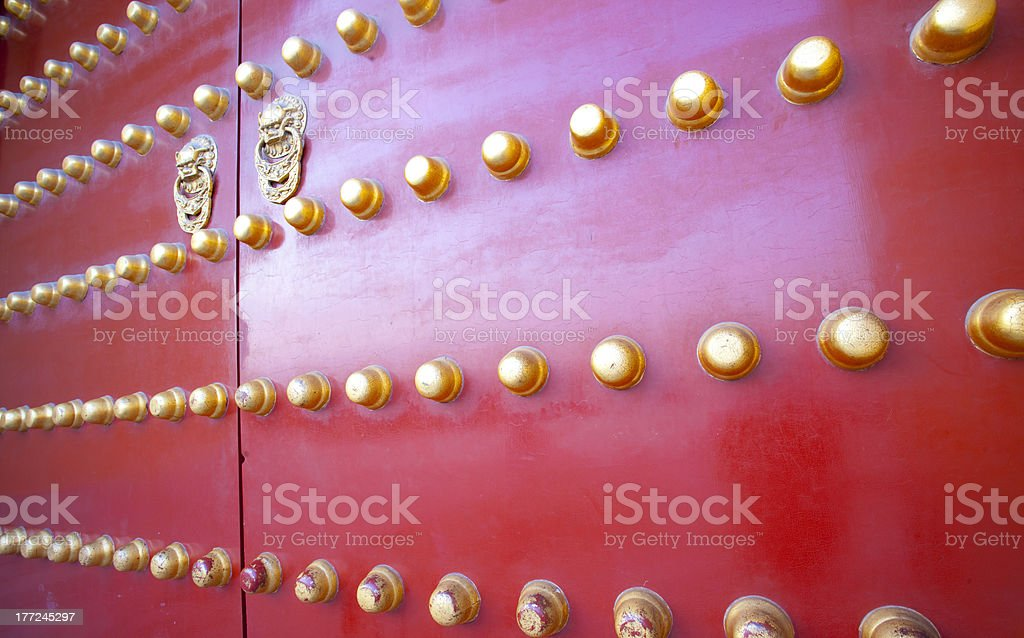 Vintage red door at Temple of Heaven in Beijing, China royalty-free stock photo