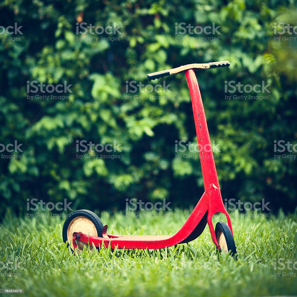 vintage red kid push scooter royalty-free stock photo
