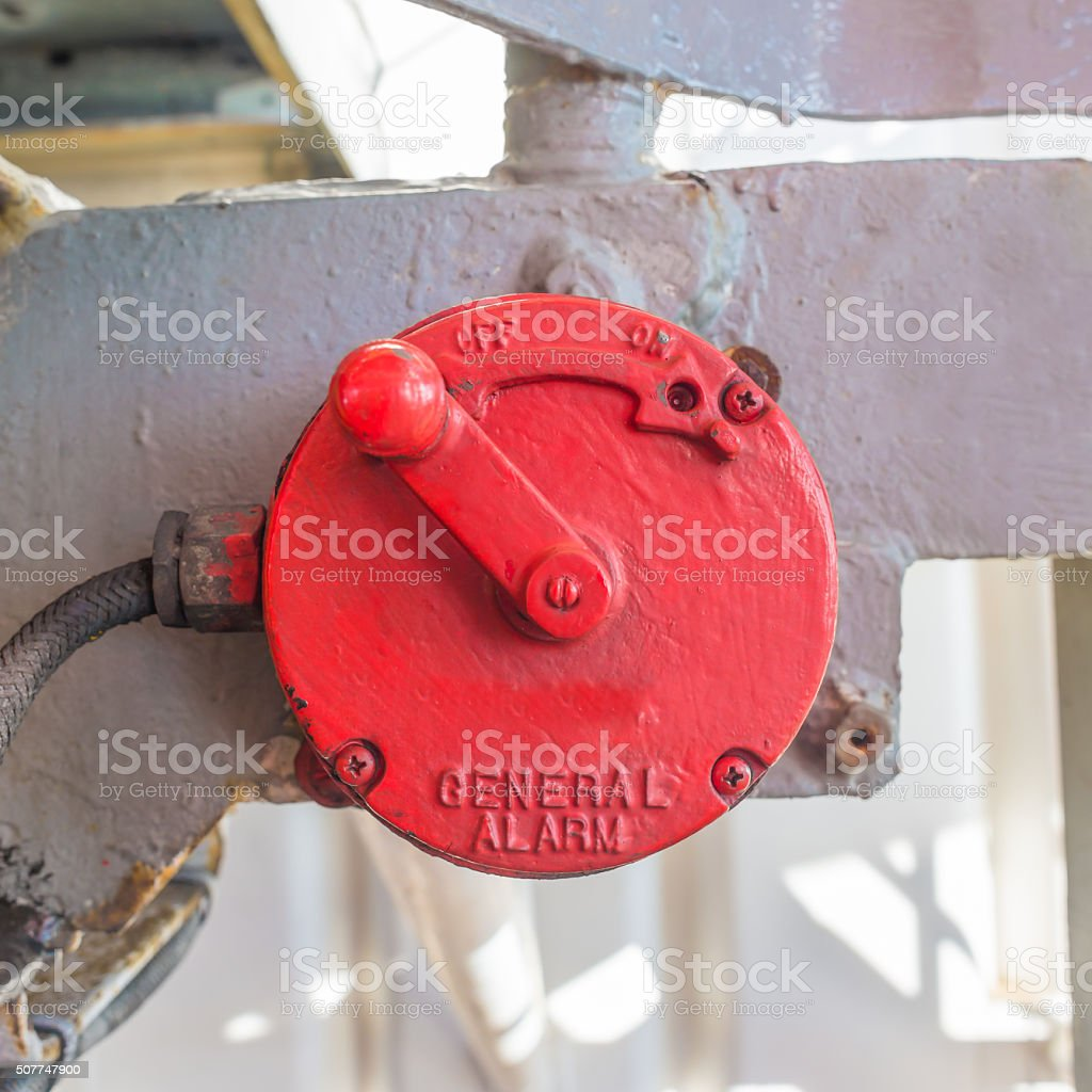Vintage red manual general alarm in oil rig stock photo
