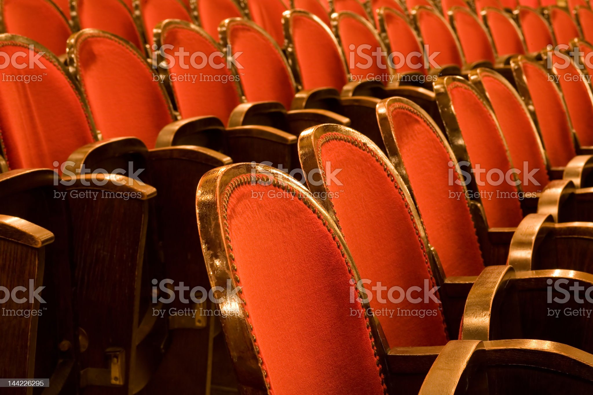 Vintage red rows of empty chairs in the theater royalty-free stock photo