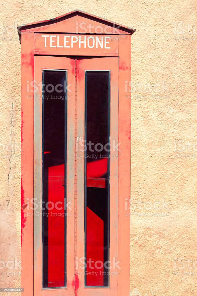 Vintage Red Telephone Box, Pinkish Background, Copy Space stock photo