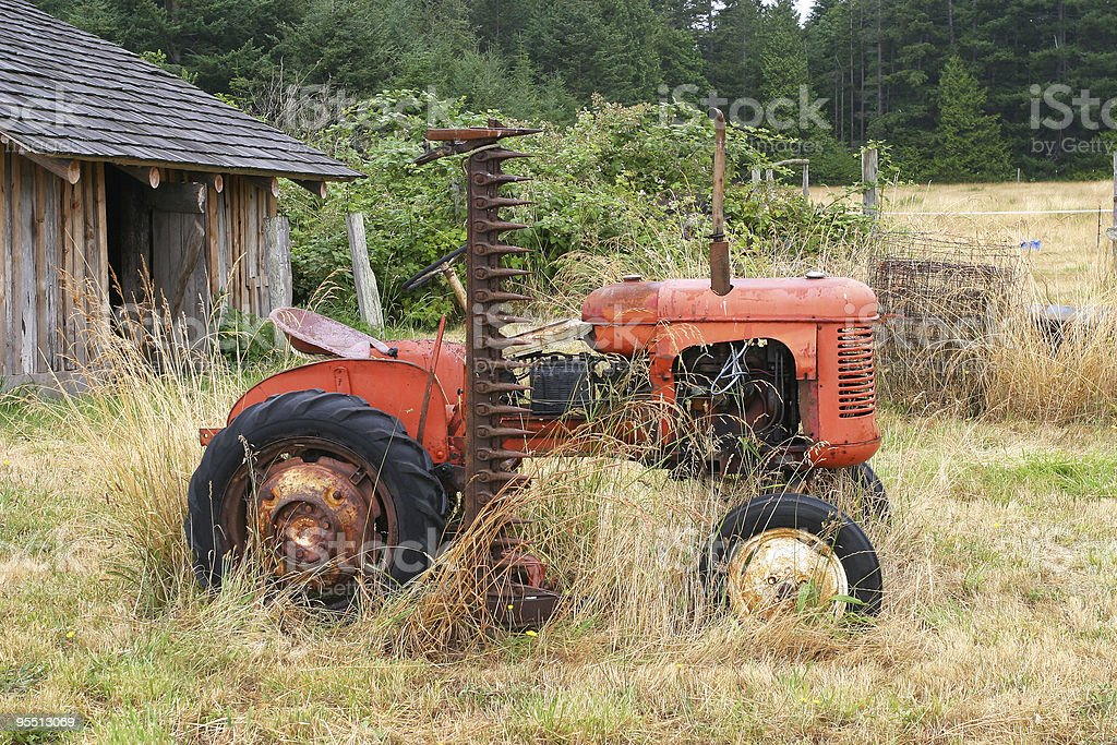 Vintage red tractor in field royalty-free stock photo