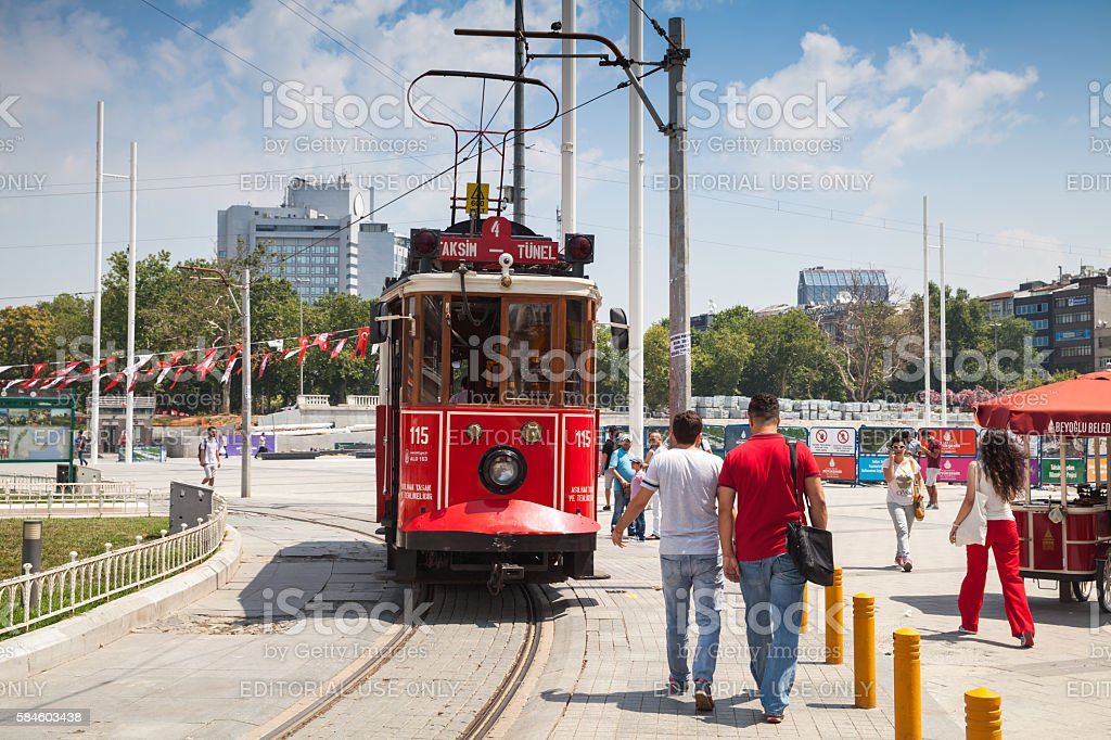Vintage red tram goes on Taksim square in Istanbul stock photo