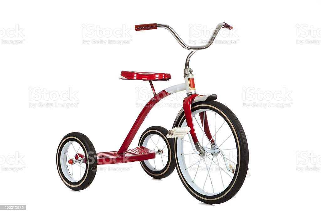 Vintage red tricycle isolated on white background stock photo