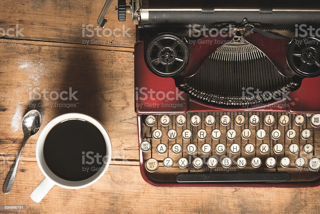 Vintage Red Typewriter and Coffee from Above stock photo
