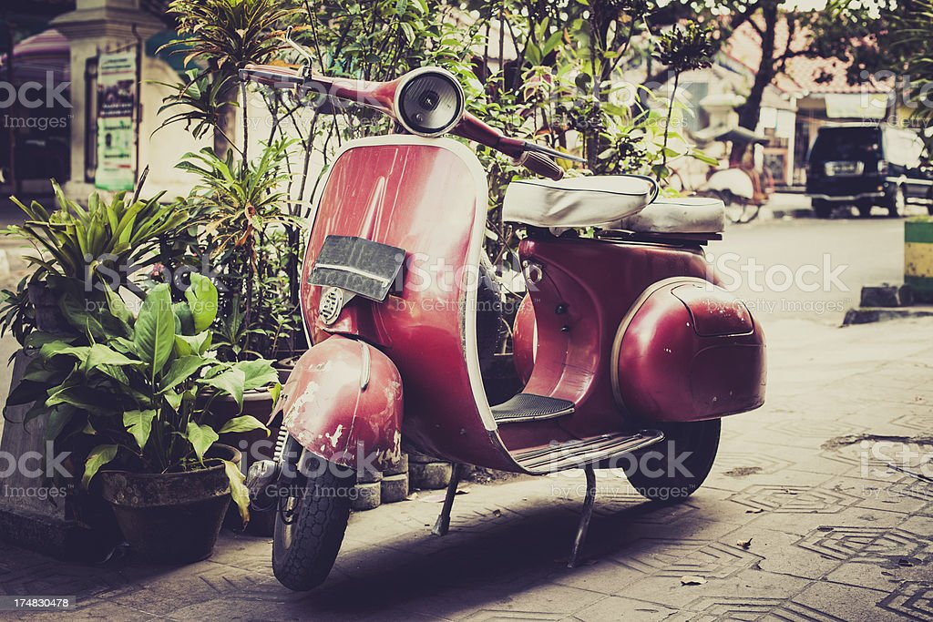 Vintage Red Vespa Scooter on the Street royalty-free stock photo