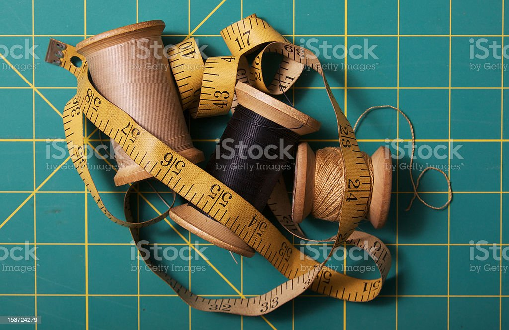 Vintage reel of thread and tape measure royalty-free stock photo
