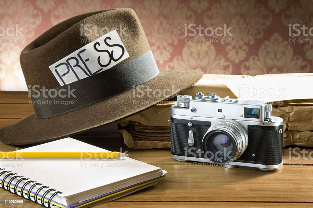 Vintage reporter fedora hat camera stock photo