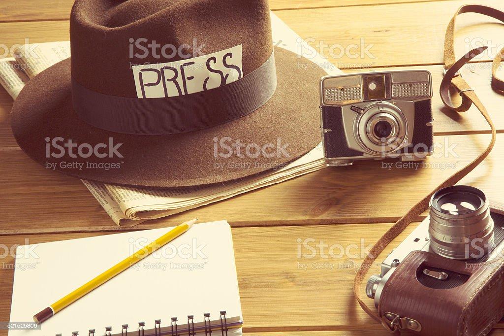 vintage reporter hat fedora camera stock photo
