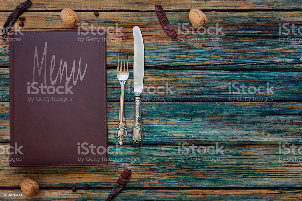Vintage restaurant menu on a rustic wood background stock photo