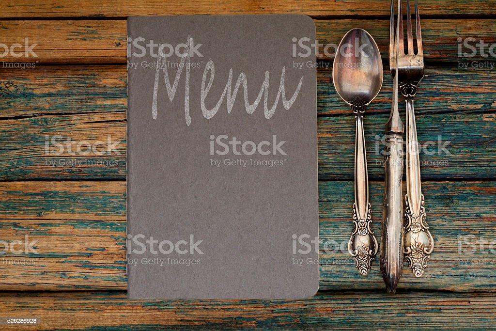 Vintage restaurant menu on a rustic wood background stock photo