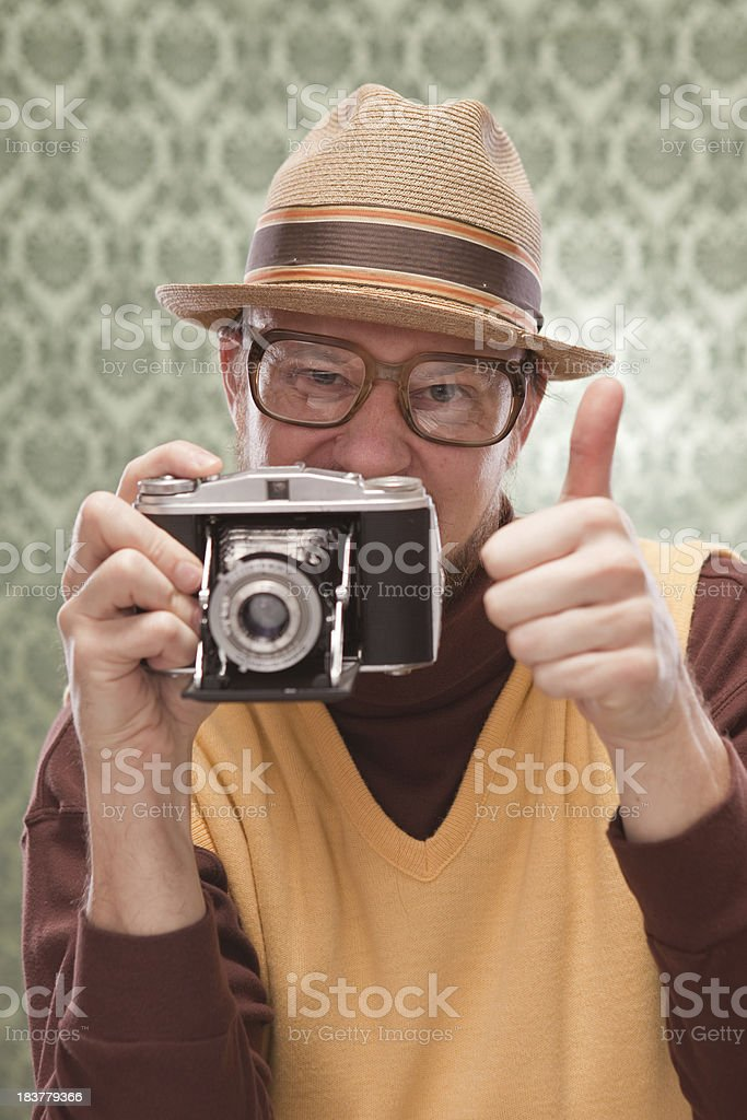 Vintage Retro Man taking photography with old camera thumbs up stock photo